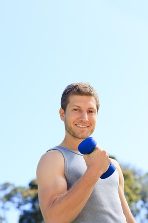 Young man doing his exercises in the park Stock Photo - 10214200