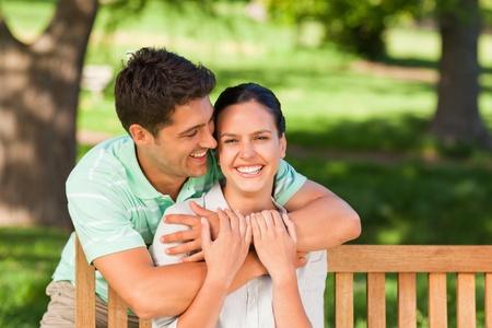 Man hugging his wife photo
