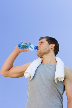 Man drinking water after the gym Stock Photo - 10216994