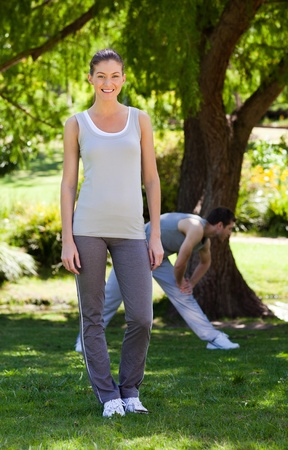 Couple doing their stretches in the park Stock Photo - 10218296