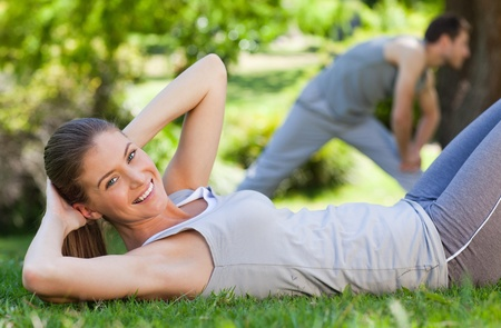 Couple doing their stretches in the park Stock Photo - 10217886