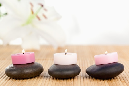 Lighted candles on black pebbles Stock Photo - 10219544