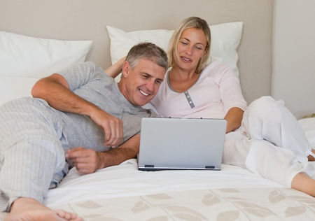 Lovely couple looking at their laptop Stock Photo - 10213220