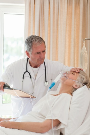 respiration: Doctor examining his patient Stock Photo