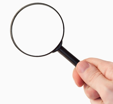 Hand holding a magnifying glass against a white background Stock Photo - 10207404