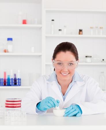 Smiling scientist preparing an experimentaion photo