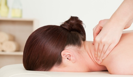 Red-haired woman having a back massage photo