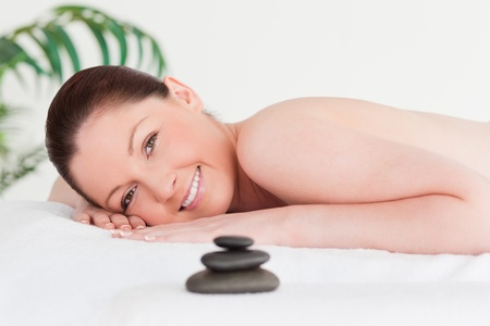 Happy young woman in a spa photo