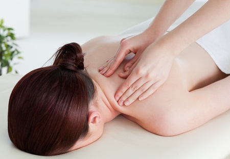 Young woman having a rolling massage photo
