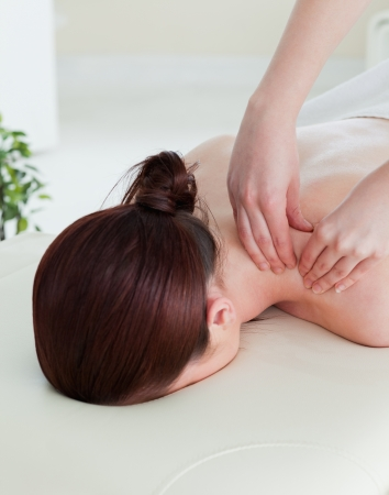 Portrait of a red-haired woman having a rolling massage photo