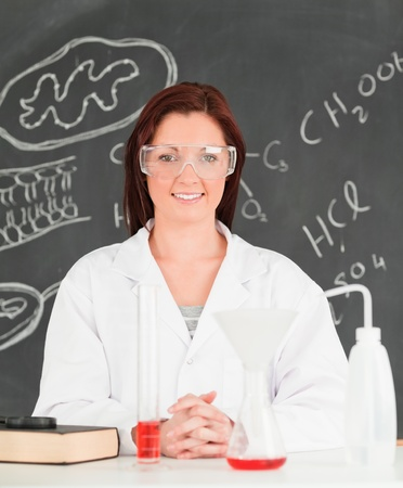 Portrait of a happy young scientist looking at the camera in a classroom photo