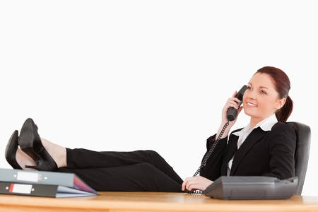 Beautiful businesswoman relaxing in her office against a white background Stock Photo - 10215499