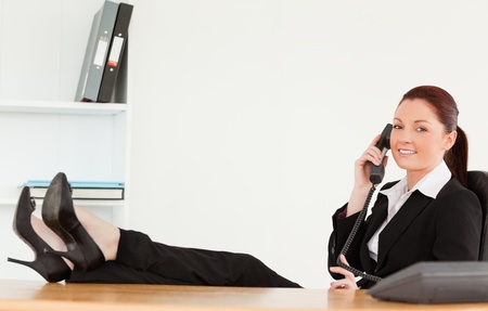 Smiling businesswoman on the phone in her office Stock Photo - 10218161