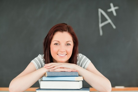 Close up of a studious young woman in a classroom photo