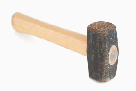 Close up of a hammer against a white background photo