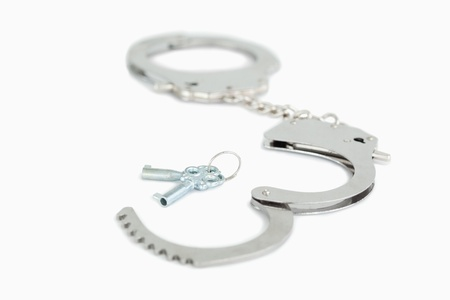 Close up of handcuffs and keys with the camera focus on the foreground photo
