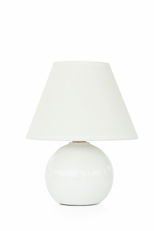 Close up of a white lamp against a white background photo
