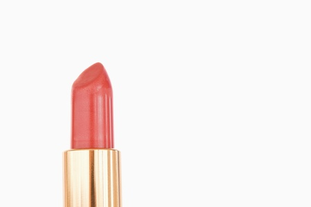 A pale red lipstick against a white background photo