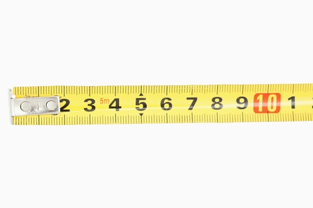 Close up of a yellow measuring tape against a white background photo