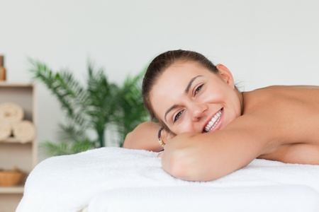 Smiling brunette waiting for a massage in a spa Stock Photo - 10221115