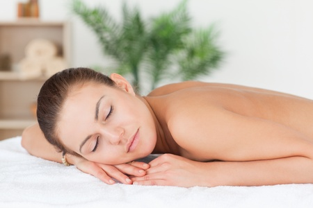Close up of a woman lying on her belly closing her eyes in a spa Stock Photo - 10229766