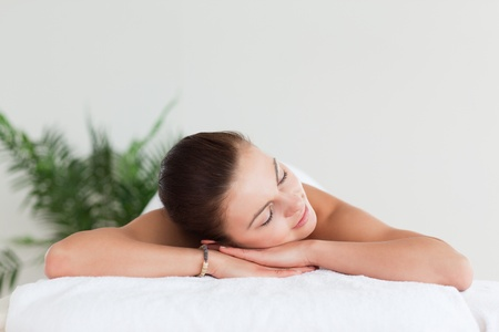 Young brunette lying on a massage table in a spa Stock Photo - 10221074