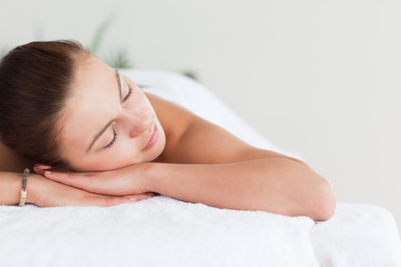 Close up of a cute brunette lying on a massage table in a spa Stock Photo - 10221014