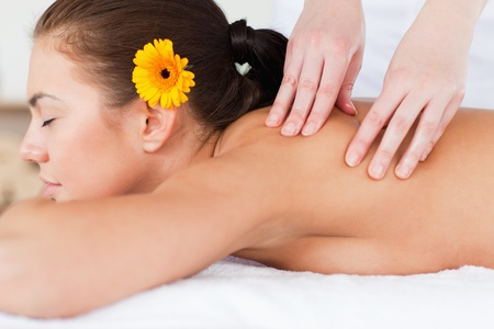 Beautiful woman having a massage in a spa photo