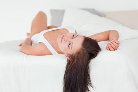 Brunette sleeping in her bedroom photo
