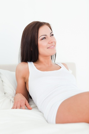 Smiling young woman posing in her bedroom photo