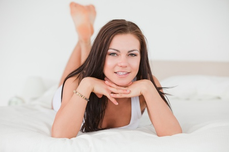 Posing dark-haired young woman in her bedroom photo