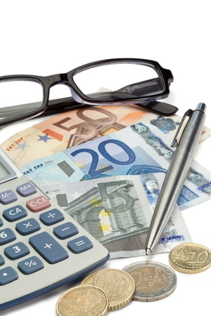 Money, pen, glasses and pocket calculator on a white background photo