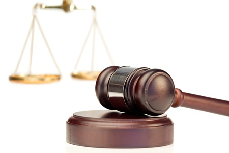 criminal case: Gavel and scale of justice on a white background