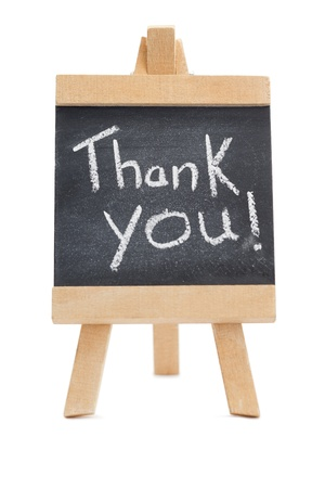 Chalkboard with the words thank you written on it isolated against a white background Stock Photo - 10232011