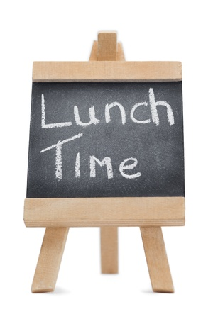 Chalkboard with the words lunch time written on it isolated against a white background photo
