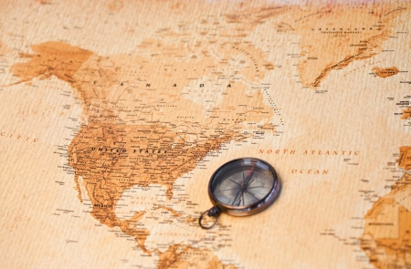 vintage world map: World map with compass showing North America