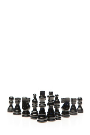 Black pieces of chess on a white background