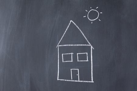 House and sun on a blackboard photo