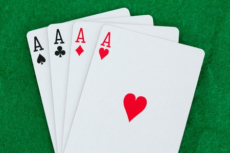Playing cards on a poker mats Stock Photo - 10233435
