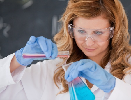 Female scientist conducting an experiment in a laboratory Stock Photo - 10231919