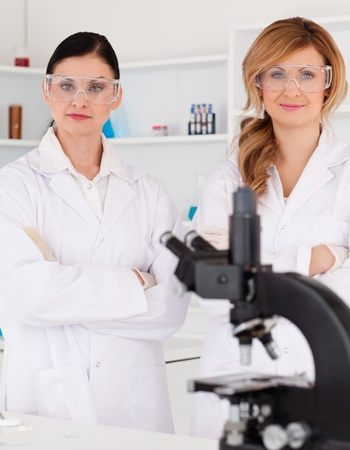Two female scientists posing in a lab photo