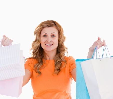 Attractive blond-haired woman showing her shopping photo