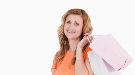 Smiling blond-haired woman showing her shopping photo