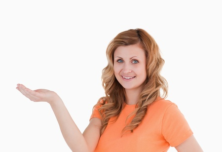 Cute woman holding her palm up Stock Photo - 10191671