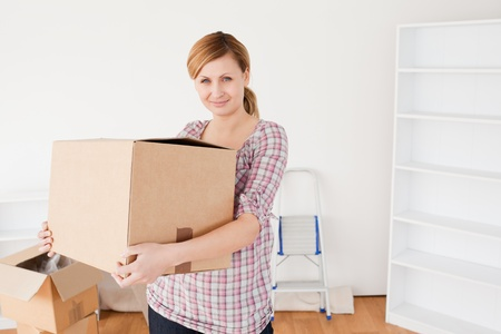 Attractive woman carrying cardboard boxes photo