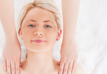 Attractive blond-haired woman having a massage in a Spa centre photo