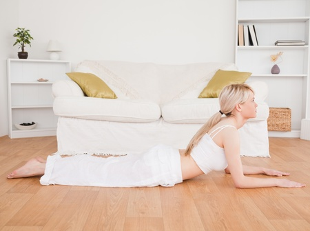 Blond-haired woman doing fitness exercises in the living-room Stock Photo - 10205749