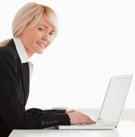 Professional female posing while relaxing with a laptop in the kitchen Stock Photo - 10191582