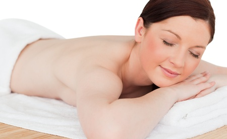 Charming red-haired female relaxing in a spa centre photo