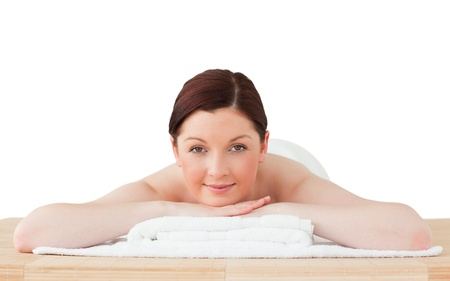 Beautiful red-haired woman relaxing in a spa centre photo